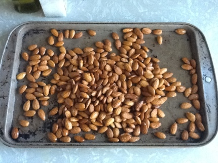 photo of raw almonds mixed with olive oil and sea salt pre-roast