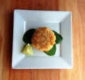 the crafty fork original crab cake with lime and baby spinach
